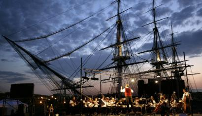 The Boston Landmarks Orchestra performs 'David and 'Old Ironsides' ' in front of the USS Constitution on Tuesday.