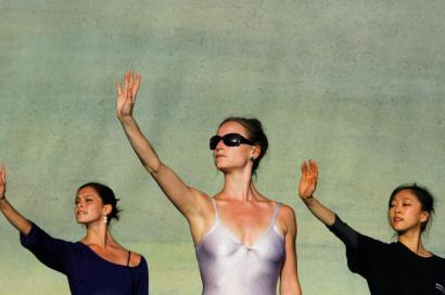 The trip has blended work and play, including (clockwise from top) Kelsey Hellebuyck carrying a case; artistic associate Trinidad Vives and artistic director Mikko Nissinen (backs to camera) addressing dancers; Megan Gray, Heather Myers, and Misa Kuranaga (from left) rehearsing; Yury Yanowsky and Karine Seneca performing; Lorna Feijoo taking a break; and Tempe Ostergren sewing poolside.
