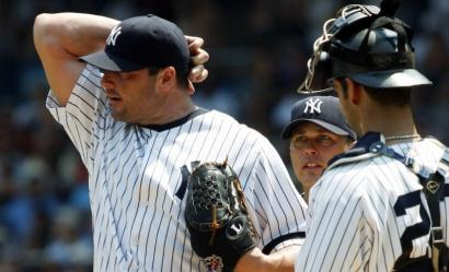 A rare head-scratcher: Yankee starter Roger Clemens, with Andy Phillips and Jorge Posada, was pulled in the second inning.
