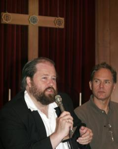 David Bentley Hart, a theologian at Providence College, answered questions as the Rev. Dale Rosenberger looked on.