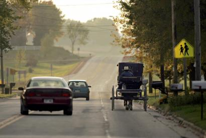 Amish in Loyal, Wis., like the Ohio Swartzentruber community, refuse to put slow-moving-vehicle signs on their buggies.
