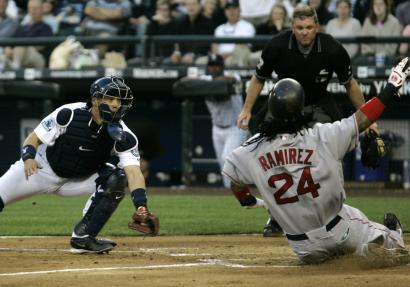 Manny Ramírez eludes Kenji Johjima's tag in the fourth inning, scoring on Jason Varitek's double for a 2-1 lead.