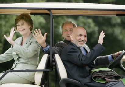 President Bush, with his wife, Laura, and the Afghan president, Hamid Karzai, drove a golf cart at Camp David.