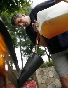 Sheila Leavitt of Newton filters cooking oil in her basement to fuel her Volkswagen Beetle.