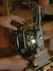 The whirring of a 16mm projector can be heard during Home Movie Day, held in Providence and other cities worldwide.