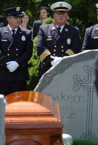 The Dover, N.H., Fire Department Honor Guard detachment stood at attention at the burial service yesterday of Irish singer and storyteller Tommy Makem, who died Aug. 1.