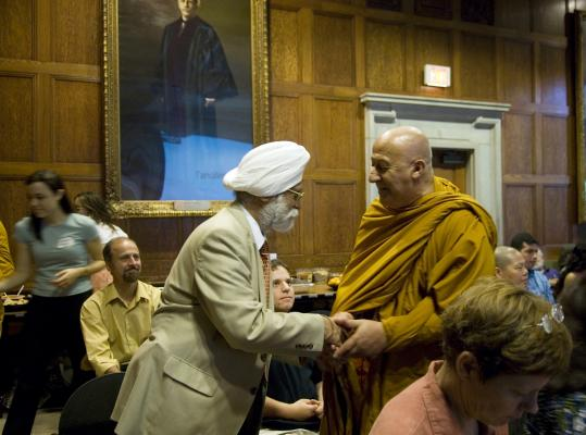 Venerable David Chutiko (right), vice abbot at the Wat Buddhabhavana of Massachusetts, greeted Jaswant Singh Chani, president of the New England Sikh Study Circle, during a symposium in Cambridge.