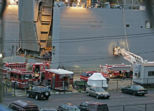 Boston firefighters fought a stubborn below-decks fire yesterday morning on a ship that is in drydock in South Boston. An aerial ladder was used to help get water hoses into the vessel, which is the size of three football fields.