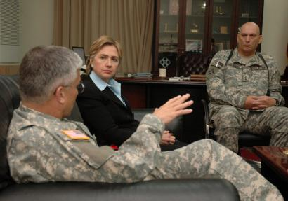 General George W. Casey Jr. (left), then-commander of multinational forces in Iraq, talked with Senator Hillary Clinton, who was part of a congressional delegation visiting Iraq in January. At right is Lieutenant General Ray Odiemo.