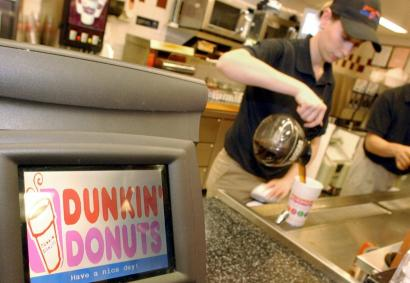 Dunkin' Donuts is moving into the Midwest, West, and South as it challenges Starbucks.