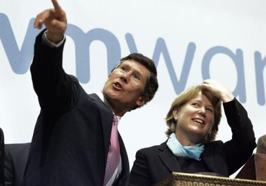 Diane Greene, president and CEO of VMware Inc., joined New York Stock Exchange chief John Thain during ceremonies at the exchange yesterday for the company's initial public offering.