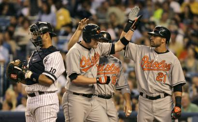 A third-inning grand slam by Aubrey Huff (center) had his Baltimore teammates up in arms.