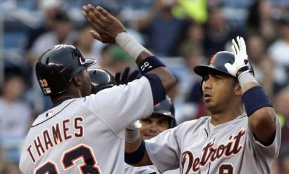 Detroit's Carlos Guillen celebrates his first-inning grand slam off Yankees' Mike Mussina with teammate Marcus Thames.