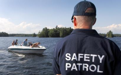 Eric Ziskend of Chestnut Hill had boaters make sure they had enough life preservers on Little Sebago Lake in Maine.