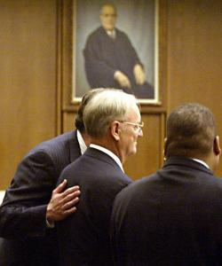John Donovan Sr. (center) was comforted by his attorney Michael Doolin (left) in Middlesex Superior Court yesterday.
