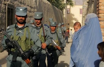 Afghan police searched a section of Kabul after four armed men kidnapped a German aid worker who was dining with her husband at a restaurant yesterday. The woman worked for a small Christian organization called Ora International.