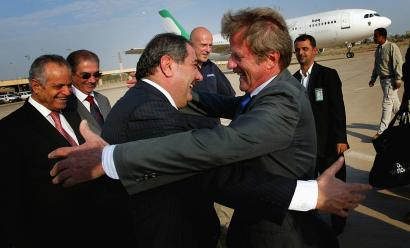 Iraq's foreign minister, Hoshyar Zebari (center), greeted Bernard Kouchner yesterday in Baghdad. Kouchner's visit was the first by a senior French official since the Iraq war started.