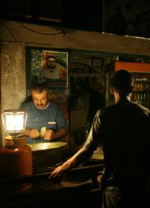 A fast-food store in Gaza City stayed open with the help of gas-powered lamps yesterday.