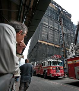 Onlookers gathered at the building in New York yesterday where investigators continued to investigate a deadly blaze.