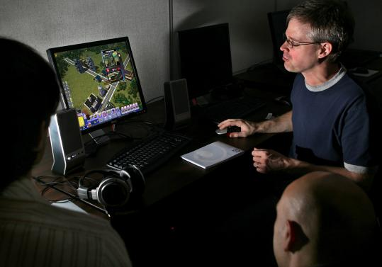 Jeff Fiske, design director for Framingham-based Tilted Mill, demonstrates the latest game in the SimCity series.