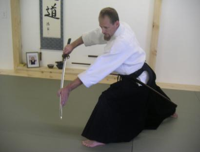 Michael Baron, owner and chief instructor at Woburn Aikikai, practices iaido, the art of Japanese swordsmanship.