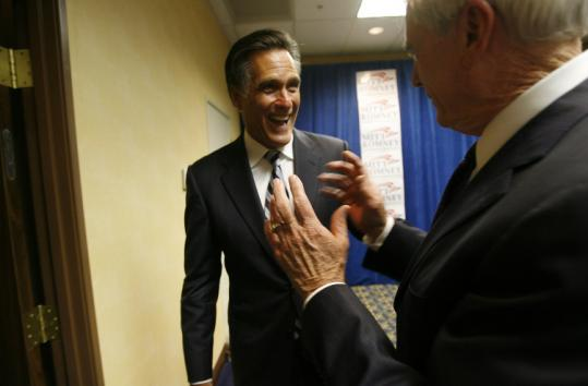 Kenny Guinn (right), former governor of Nevada, joked with Mitt Romney yesterday in Las Vegas, where the Republican contender is campaigning for president.