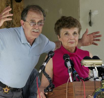 Ed and Elaine Brown, addressing reporters during a press conference in Plainfield, N.H., in June, have been convicted of tax evasion and have been holed up in their home.