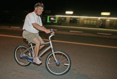 Mayor Thomas M. Menino pedaled down River Street in Hyde Park yesterday on his daily predawn bike ride.