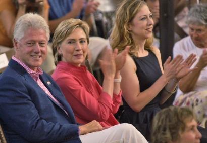 Former president Bill Clinton sat with Senator Hillary Clinton and daughter Chelsea during a fund-raiser yesterday in Oak Bluffs on Martha's Vineyard.