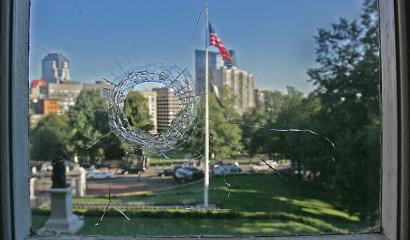 The bullet hole was seen in the window of the constituent services office at the State House yesterday. Police are investigating.