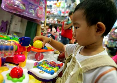China is cracking down on toy makers, two weeks after Mattel Inc. recalled almost 19 million dolls, cars, and action figures because they contained lead paint or tiny magnets that could be swallowed by children. Above, a department store in Beijing.