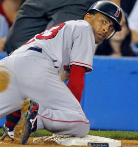 Looking back on it, Julio Lugo realizes he's gotten safely back to third on Dustin Pedroia's shot to the mound in the third.