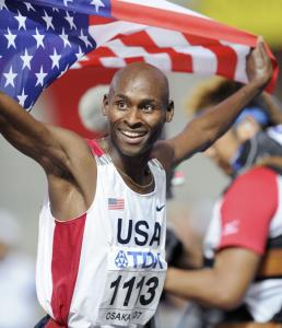 Bernard Lagat, a US citizen since 2004, celebrates after becoming the first American to win a world 1,500-meter title.