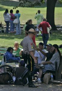 A park ranger on patrol passed homeless people on Boston Common yesterday.