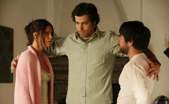 Zachary Levi (center, flanked by Sarah Lancaster and Joshua Gomez) plays the title character in NBC's new series ``Chuck.'