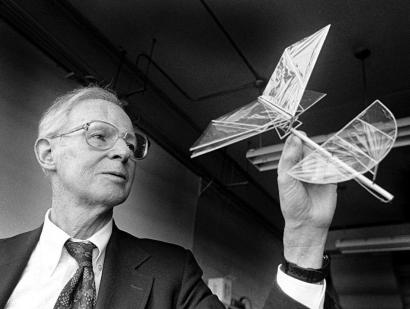 Aircraft pioneer Paul MacCready demonstrating his one-gram ornithopter. Dr. MacCready's Gossamer Condor hangs at the Smithsonian Institution.
