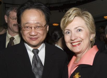 Norman Hsu, with Hillary Clinton at a 2005 fund-raiser, said he will stop raising money until his legal issues are resolved.