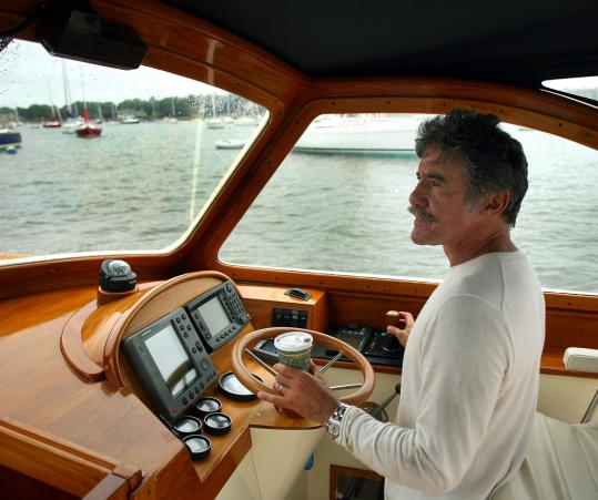 Geraldo Rivera manuevers his boat into the harbor in Marion. He's famous for his reporting style, but he's also an accomplished sailor.