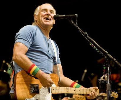 Jimmy Buffett performed with his Coral Reefer Band, to a laid-back but appreciative crowd at Gillette Stadium on Sunday.