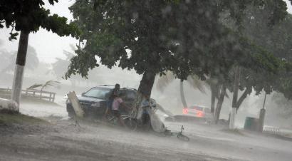 People took cover in La Ceiba, Honduras, as Hurricane Felix neared yesterday. Henriette pounded resorts in Baja California.