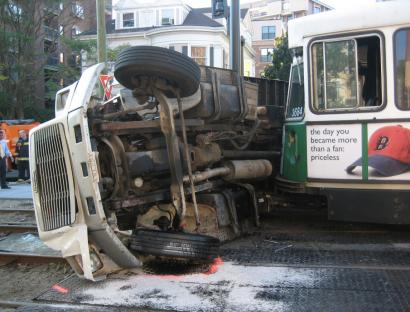 A Green Line trolley and a flatbed truck collided at Beacon and Charles streets yesterday.