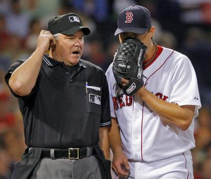 After the fourth, Josh Beckett had an apparently secret word with plate umpire Dana DeMuth.
