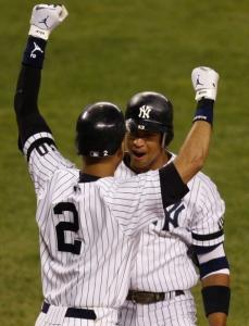 Alex Rodriguez is greeted by Derek Jeter (2) after hitting his second home run of the seventh inning.