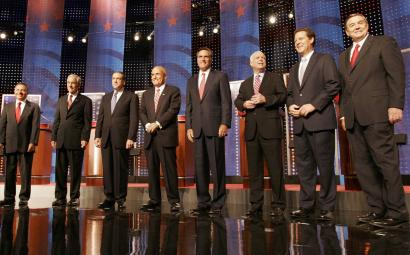 From left, Representative Tom Tancredo of Colorado, Representative Ron Paul of Texas, former Arkansas governor Mike Huckabee, former New York mayor Rudy Giuliani, former Massachusetts governor Mitt Romney, Senator John McCain of Arizona, Senator Sam Brownback of Kansas, and Representative Duncan Hunter of California gathered in Durham, N.H.
