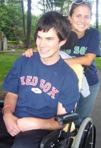 Michael Milmoe with his sister, Meaghan. The heart attack victim, now 21, beat expectations.