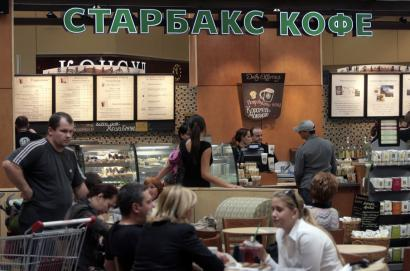 The first Starbucks in Russia opened in a shopping mall in Khimki, just north of Moscow - but only after a court fight over the company name, which a Russian 'squatter' had tried to claim.