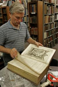 Ken Gloss, an appraiser and the owner of Brattle Book Shop, flipped through a Bible published in 1792, the first version of the holy book made in New York state.
