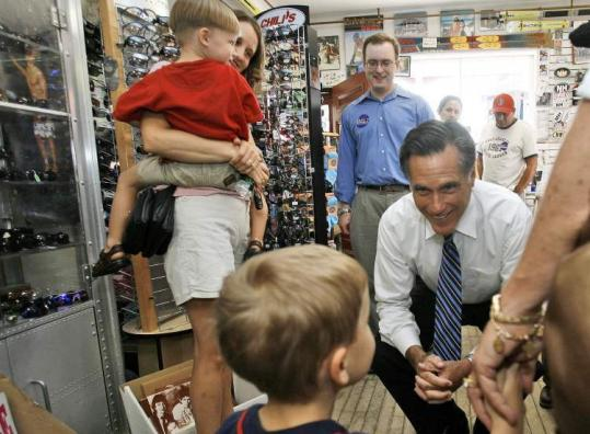 Former Massachusetts governor Mitt Romney greeted Michael Maccini during a campaign stop at Lahout's Country Clothing and Skip Shop in Littleton, N.H., yesterday