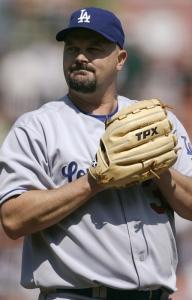 David Wells grimaces after Kevin Frandsen's single spoiled his perfect-game bid in the sixth inning.