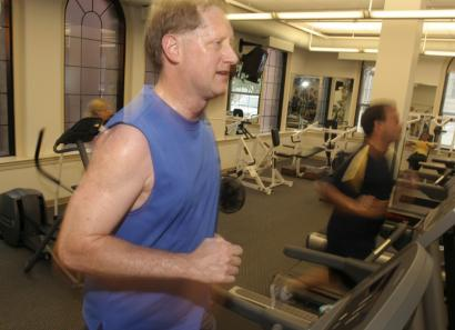 Tom Johnson runs on a treadmill at the Western & Southern Financial Group headquarters in Cincinnati. The company is encouraging employees to reduce their health risks.